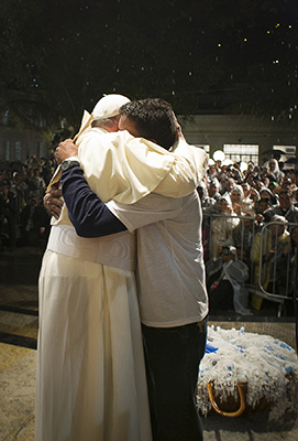 Pope Francis embraces patient at hosptial in Rio de Janeiro