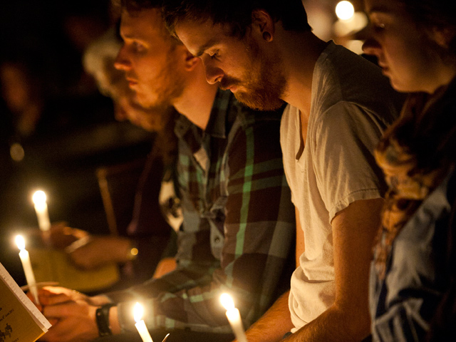 Men-praying-with-candles